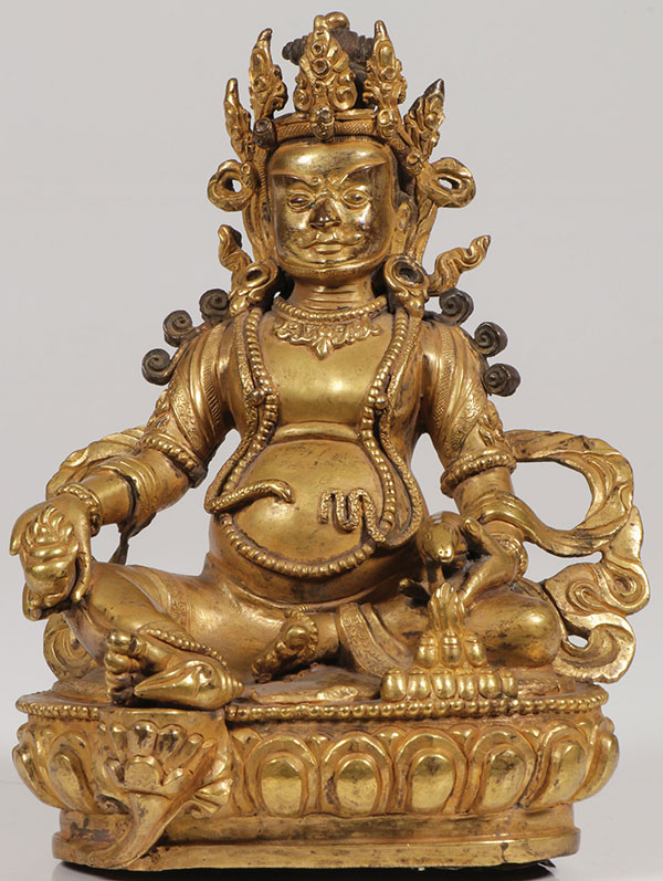 SINO-TIBETAN GILT BRONZE FIGURE OF VAISRAVANA.