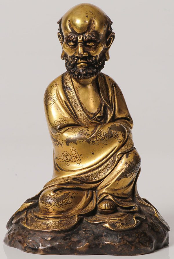 CHINESE GILT BRONZE FIGURE OF A MONK.